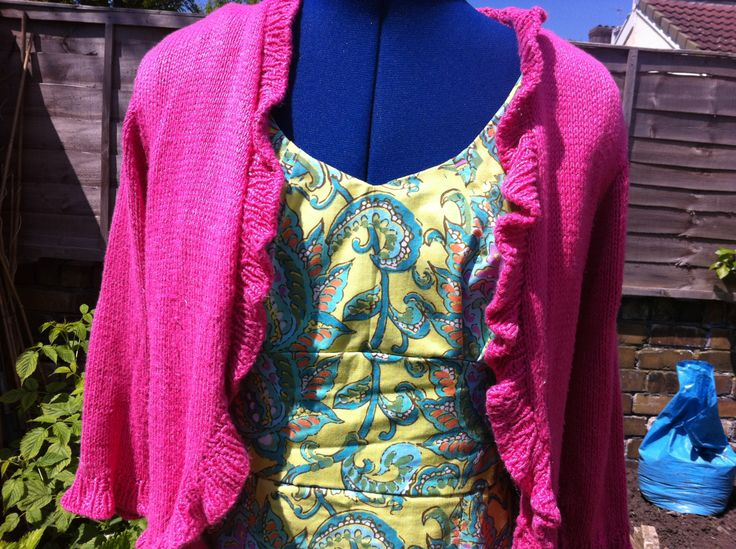 Green Amy Butler dress again with a handknitted pink cardigan with ruffle edge...