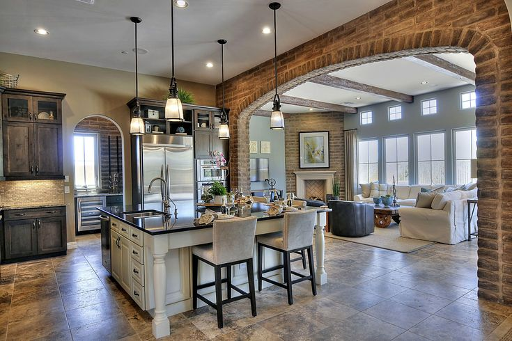 So much to love about this gorgeous open kitchen-living room feat. Maxim Lighting Hi-Bay pendants! | Del Mar Fans & Lighting
