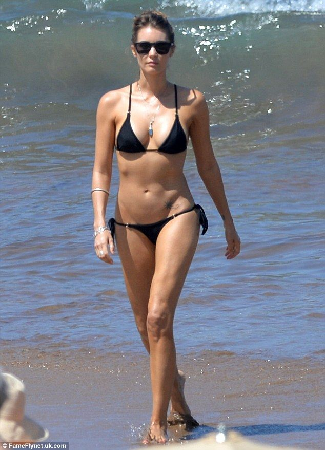 Sizzling: Tanit Phoenix made a beach in Maui, Hawaii her own personal runway as she steppe...