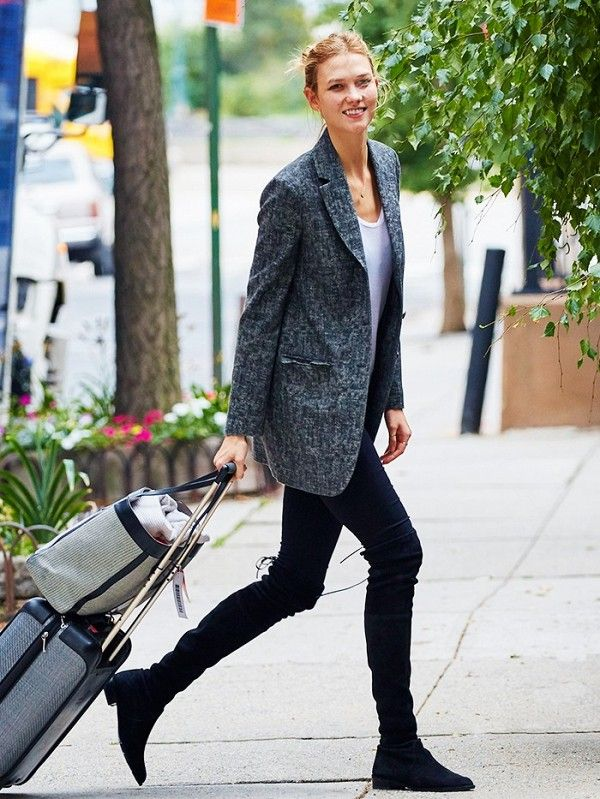 Karlie Kloss makes leggings look chic when paired with a blazer and over-the-knee boots