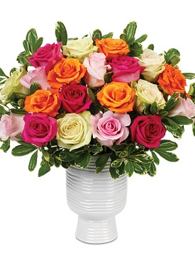 """A quintet of lime-colored roses (a variety called """"Green Fashion"""") that appear to turn up the intensity of the other roses' hues. The pinks become pinker and the orange more bright, while variegated pittosporum appears to hold it all together."""