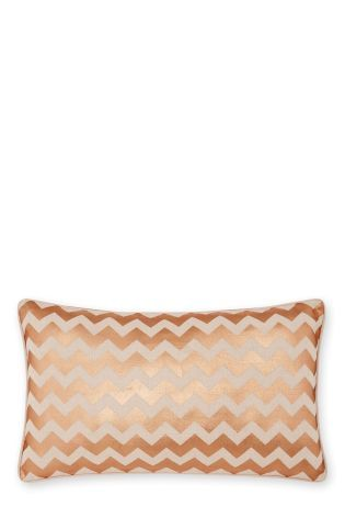 Add a hint of luxe to your living room with this Copper Zig Zag Cushion, £12, Next.