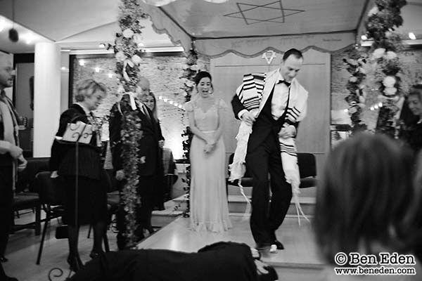 Mazel Tov: the groom breaks a glass by stepping on it