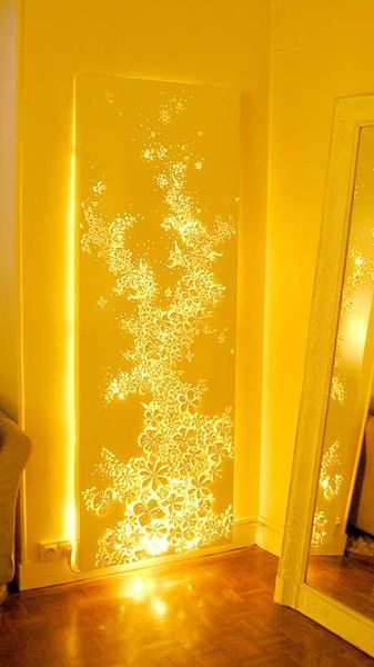 DIY Lighting...use tall canvas, apply stickers, decal, etc., and spray paint. Remove Decals; hang white lights behind it.