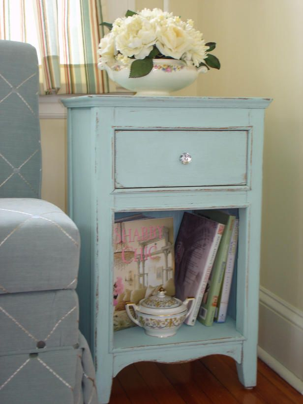 he Blue and the Beautiful  If pink isn't your thing, embrace your blue period by painting a piece of furniture a sweet pastel in the cool color. Bonus points if you can find an antique piece that doesn't need to be painted and distressed by hand. This light-blue side table invites people to relax and enjoy a book in this guest room's sitting area.