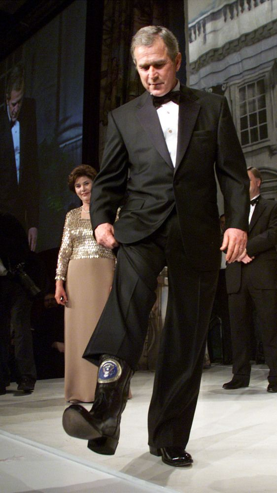 George W. Bush, 2001 wearing cowboy boots. I just love this guy on a personal level. He was such a real person, a mans man!