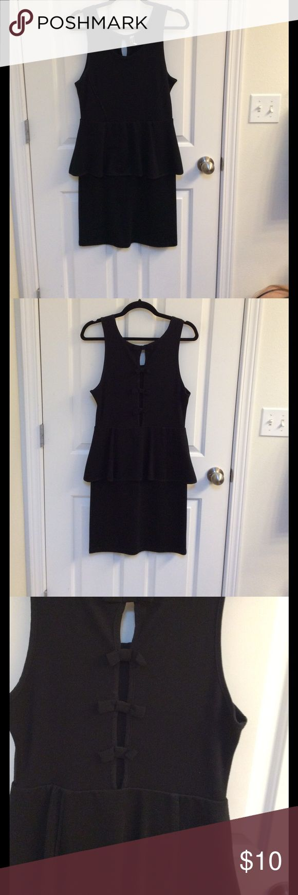 Woman's Poof Couture black cocktail dress size L Woman's Poof Couture cocktail dress in size Large, color is black, back side has an opening with four bow ties. No stains or tears, good used condition! Poof Couture  Dresses Mini