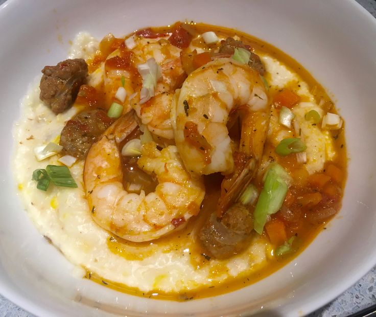 Shrimp and spicy sausage over creamy stone-ground grits in a light tomato vegetable broth.