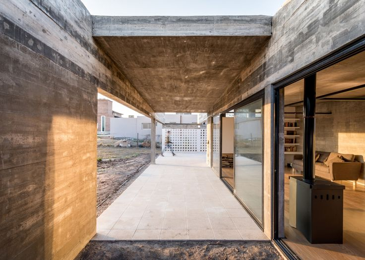 House By Tectum Features Raw Concrete Walls And Black Metal