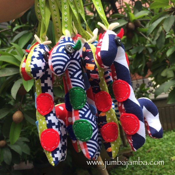 Little Giraffe Ornaments for baby Zaky who is turning 1 this weekend   To adopt one of our animal pillows visit www.jumbajamba.com