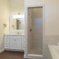 Transitional Bathroom Features Calming Neutral Colors ...change up mirror frame and vanity color