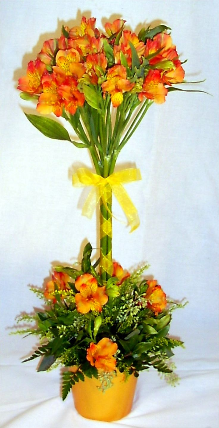 Alstromeria topiary-style centerpiece. Cute for a bridal shower.