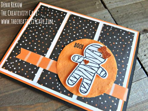 The mummy may be from the Cookie Cutter Halloween stamp set, but your card will not be like all the rest! Watch the video tutorial to pull together this DIY Halloween card. Use your bone folder to make the faux suede circle!
