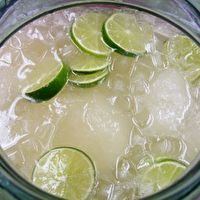 """Margarita"" Punch by Kate Van Gorden6 oz frozen lemonade concentrate 6 oz frozen limeade concentrate 1/2 cup powdered sugar 3 cup crushed ice 1 liter Sprite or other lemon-lime beverage 2 thinly sliced limes"