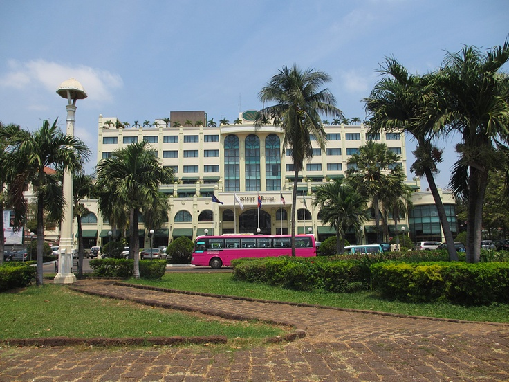 Sunway Hotel - Cambodia  Here's a photo I took earlier today of the Sunway hotel in Phnom Penh. I was attracted to the pink coach (bus) parked outside the main entrance, as I thought it complimented the beautiful blue sky and surrounding greenery.  The hotel is located next to the famous Wat Phnom park and across from the US Embassy. The riverside is just a 5 minute walk away.  ---  Cambodia Hotels and Tours:  www.tropicalasiatravel.com