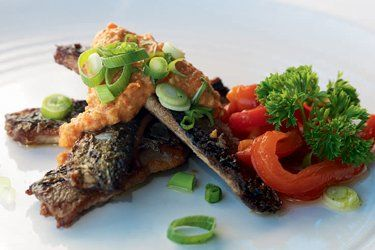 Grilled pilchards with romesco sauce