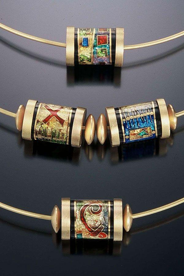 Barrel slider pendants by N. Carolina jeweller James Carter. Gold, cloisonné enamel.