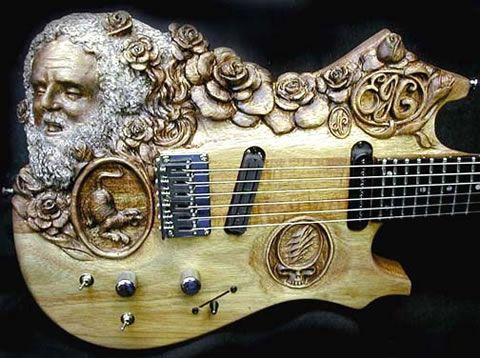 Doug Rowell made many cool carved guitars – this one is Jerry Garcia in Roses.....thought of Brennan