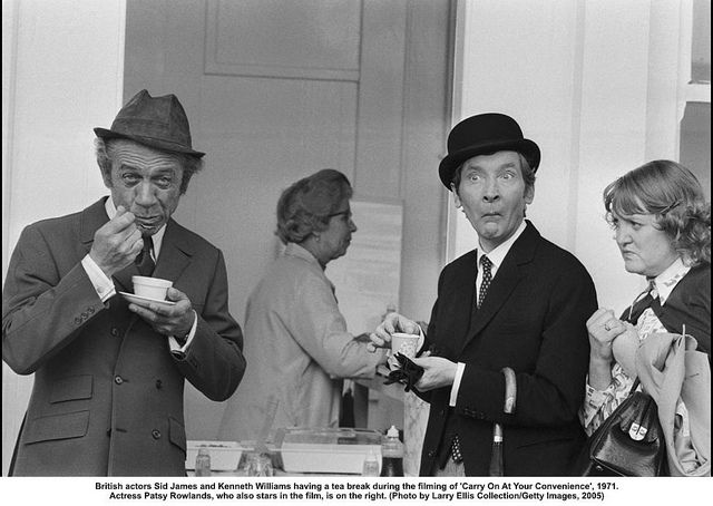 British actors Sid James and Kenneth Williams having a tea break during the filming of 'Carry On At Your Convenience', 1971