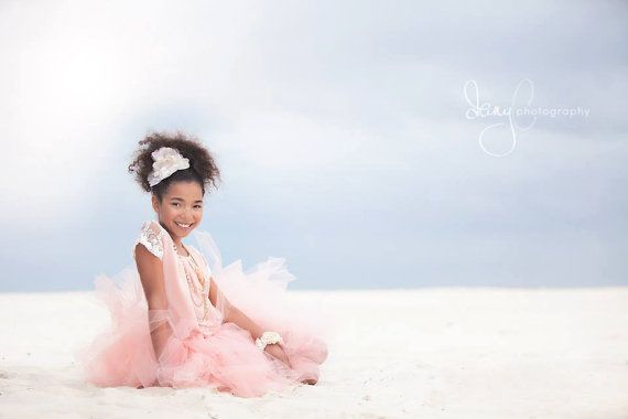 In love with this shabby chic, peaches and cream tutu from Atutudes. Made with over 100 yards of the finest lead-free, flame retardant tulle that is made in the USA. This stunning photo by Dany C Photography was captured in Gulf Shores' Alabama. #tutu #peachtutu #blushtutu #shabbychic #madeintheusa