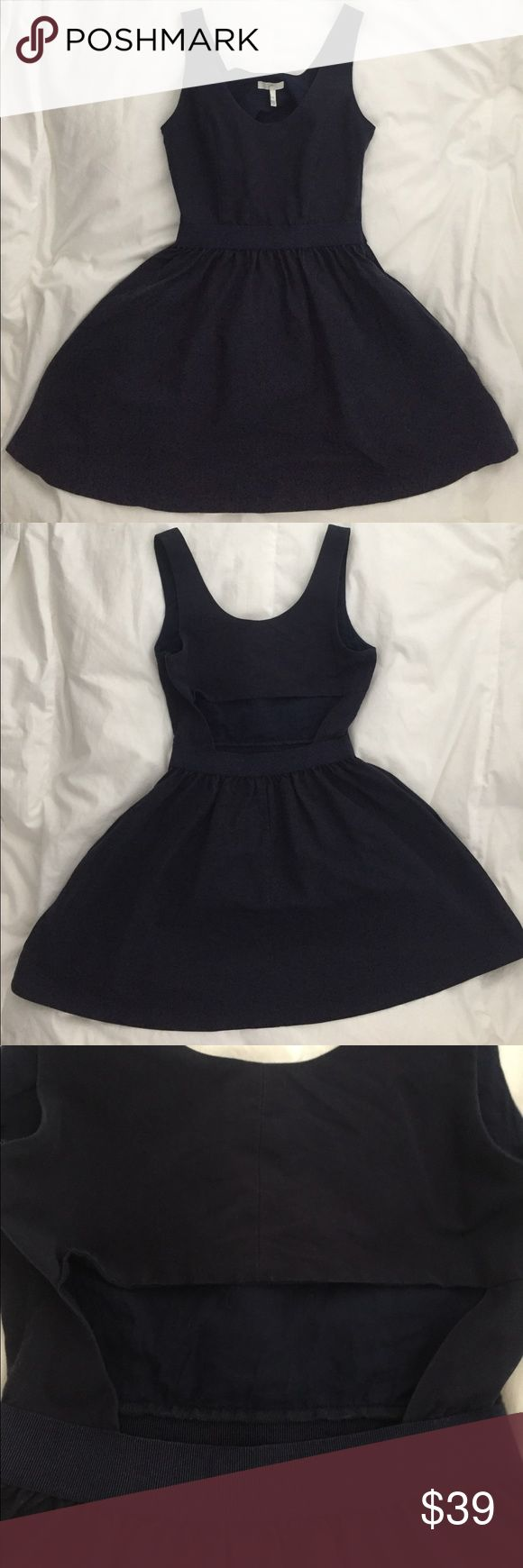 Super cute, navy blue, Joie cut out dress! This Joie dress is so perfect for summer BBQs. The cut out in the back is super cute and it has pockets! Would look great with wedges or some sparkly flats. Color is Navy blue! Joie Dresses Mini