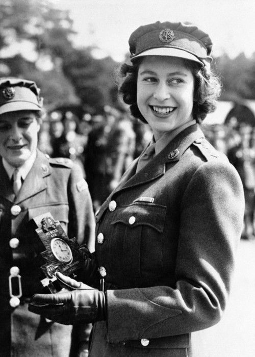 August 3, 1945: HRH Princess Elizabeth is presented with a clock after being promoted to a Junior Commander of the Women's Auxiliary Territorial Service during World War II.