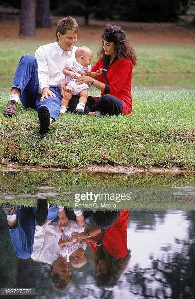 Portrait of Southern Mississippi QB Brett Favre (4) casual, posing with his girlfriend Deanna and their daughter Brittany during photo shoot near lake. Ronald C. Modra, from gettyimages