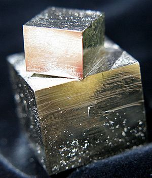 Amazing Natural Pyrite Cube Twin: photography by Loren Warn : Pixie Crystals : www.pixiecrystals.com   Amazing TOTALLY Natural Pyrite Cube Twin - one large crystal and a smaller cube crystal perched and just attached to the larger crystal by one corner!   #pixiecrystals