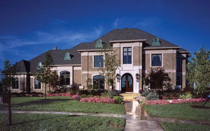 This spectacular home    solid brick  limestone trim  and a    This spectacular home    solid brick  limestone trim  and a custom wood entry door boasts an exterior that reflects an authentic European manor