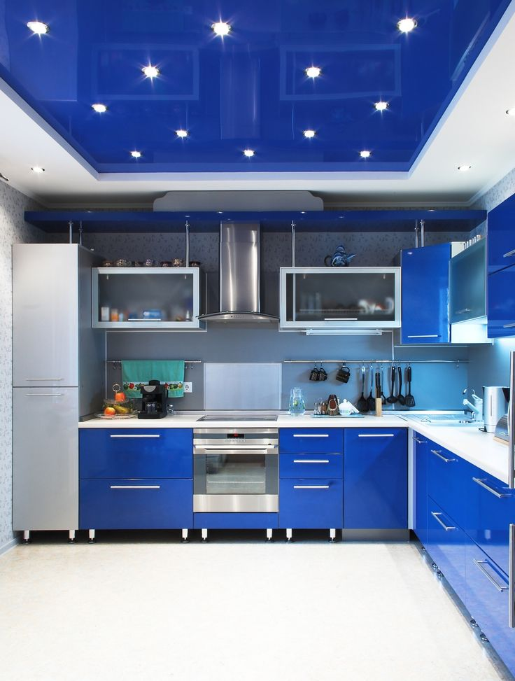 Blue lacquer stretch ceiling in a kitchen. Blue ceiling and blue furniture looks amazing. You are free to choose your own ceiling design or we can offer you our variants of a ceiling according to your design.