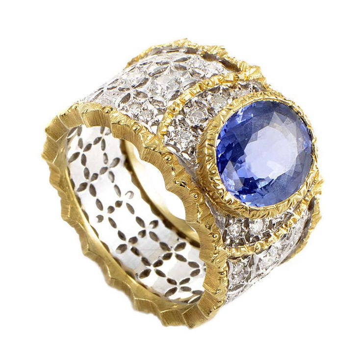 Buccellati Sapphire Diamond White and Yellow Gold Band Ring | This fantastic band ring from Buccellati has an air of regality that is incomparable! The ring is made primarily of diamond-frosted white gold with yellow gold trimming. Lastly, the ring's main attraction is its ~3.50ct bezel-set sapphire.