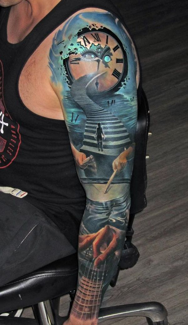 Exciting looking sleeve tattoo. There are many things that incorporate this tattoo just like the clock on top followed by a stairs with a person climbing it. You can see below these images are a pair of drums being played and a guitar being played as well.