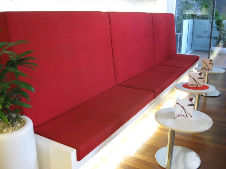 Red statement banquet seating by Eurofurn.