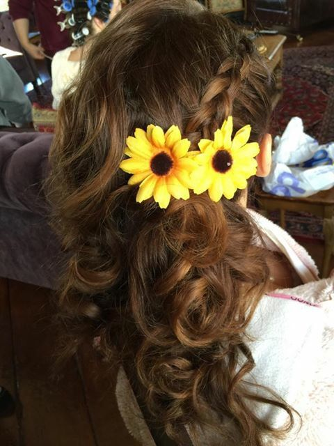 This is a hairstyle which I created for a bridesmaid in a wedding. I started off by using heated rollers to curl the hair and give it some volume and then I finished curling the hair with hair straighteners. I then created a Dutch braid and added some accessories to finish of the hairstyle.