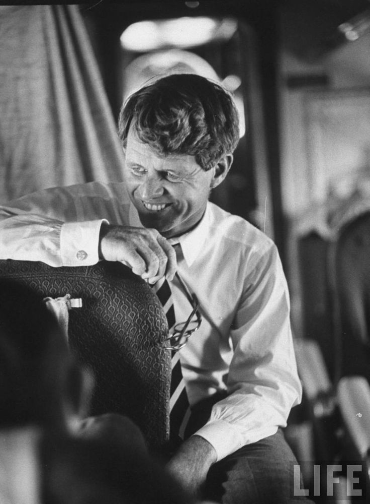 Sen. Robert F. Kennedy aboard plane traveling to compaign for local Democrats. Location:	US Date taken:	September 1966 Photographer:	Bill Eppridge