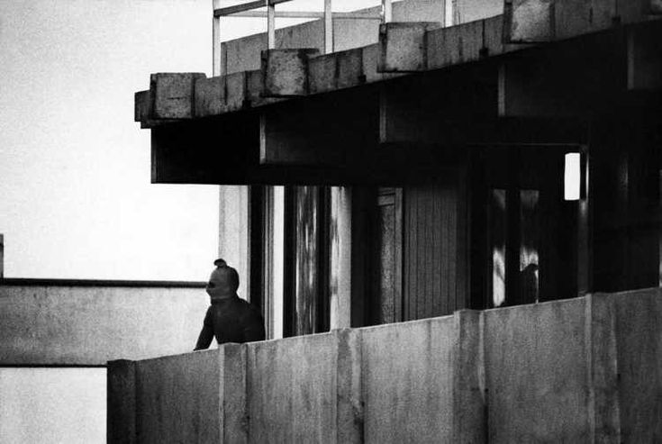 The Munich massacre occurred in 1972 during the Summer Olympics when members of the 11 members of the Israeli Olympic team were taken hostage and eventually killed by the Palestinian group, Black September. This eerie image captures one of the kidnappers standing in their hotel balcony during the siege.