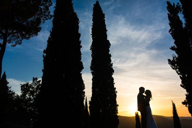 The newlyweds in Tuscany, enjoying this awesome sunset. Photography: Cadence & Eli Photography | Planning: Fete Perfection | Venue: Villa Vignamaggio  #Italy #Couple #silhouettes #weddinginItaly #black