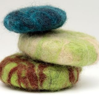 I got a felted soup bar for Christmas and love it. It exfoliates your skin and keeps your soap bar from slipping out of your hand. Check out the felted soap lady from WI.