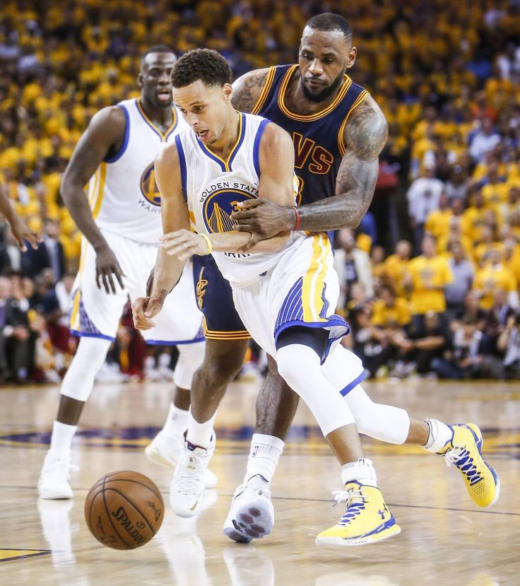 Golden State Warriors' Stephen Curry is guarded by Cleveland Cavaliers' LeBron James in the second period during Game 1 of The NBA Finals on Thursday, June 4, 2015 in Oakland, Calif. Photo: Scott Strazzante, The Chronicle
