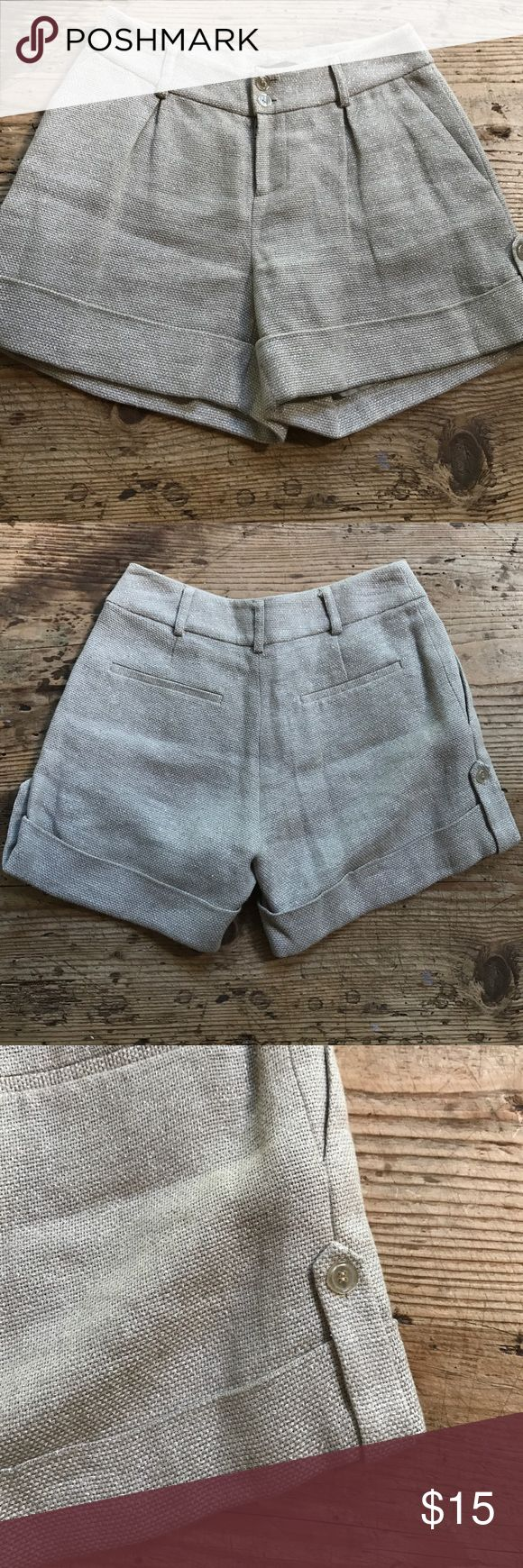 Linen dressy shorts by Saja size 0 Boutique Linen pleated and lined dressy shorts size 0. These have the coolest golden sheen to them with a touch of sparkle. Super dressy. Pockets. Size 0. Would also fit a 00. Saja Shorts
