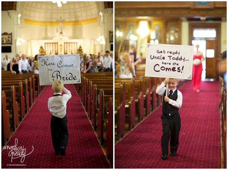 what a cute detail - page boy with 'here comes the bride' sign
