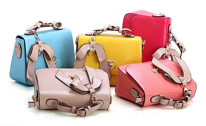 linmeimode sweet bow bag high quality sexy patent imitation leather woman bag http://www.dhgate.com/store/product/sweet-bow-bag-ladies-wild-new-fashion-patent/212108617.html