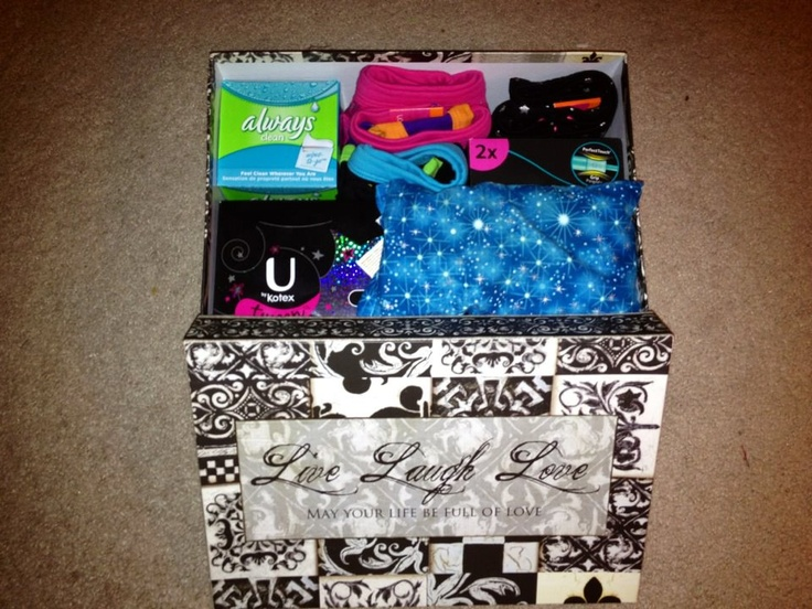 """""""First Period Box"""" with """"Tween"""" pads and tampons, """"period"""" underwear, wipes, heating pad, chocolate, and a note from mom. The box is photo box and can be used to keep supplies under the sink after the big day!"""