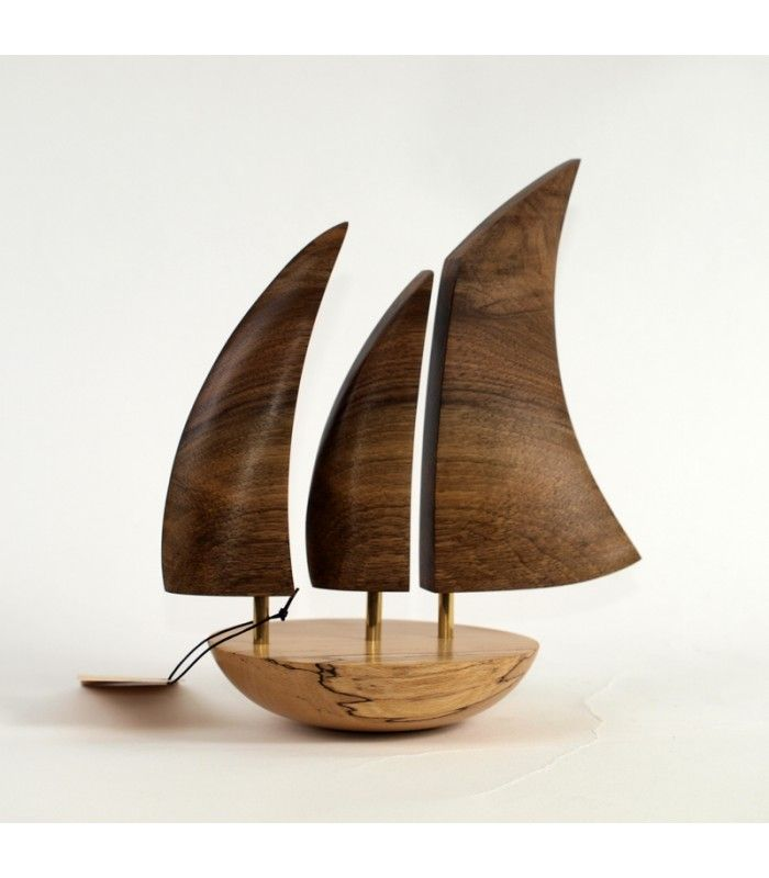 Exquisite Balancing Boats by Reborn Art are inspired by the iconic Galway Hookers and fasioned from the finest Irish hardwoods. They areperfectly balanced on their rounded base, with a gentle push appear to be sailing on the ocean. Base is made of black walnut. Sails are variationof wood including spalted Beech, Ash, Cherry, Oak, Sycamore, Walnut, Elm and Sweet chestnut.