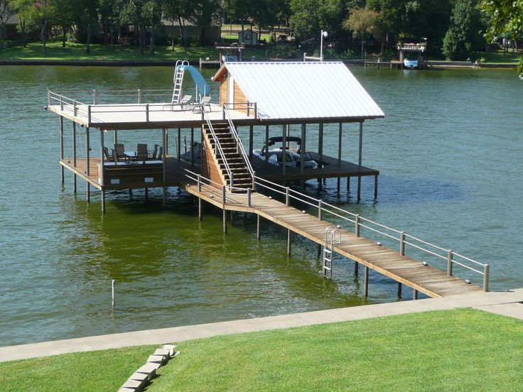 Dock Design Ideas this deck over the water includes concealed storage areas a ramp into the water and Best 25 Boat Dock Ideas On Pinterest Dock Ideas Lake Dock And Boathouse