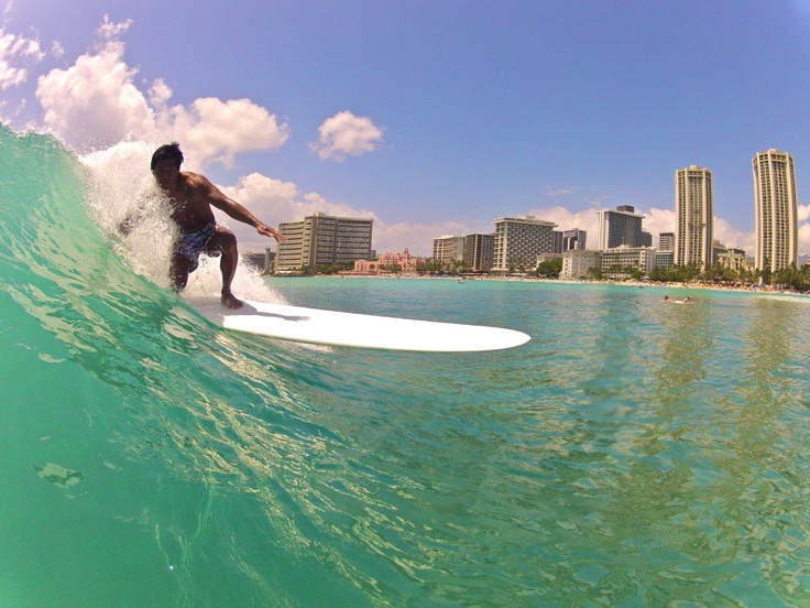A day out longboarding at Queens, in Waikiki, Hawaii