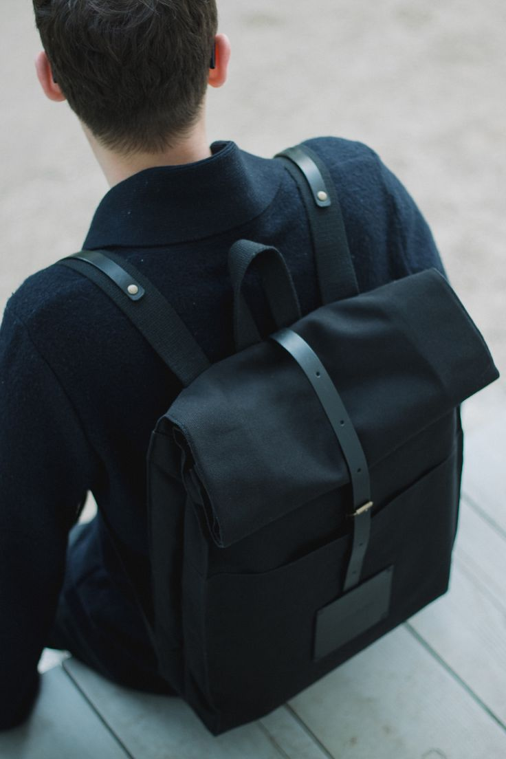 Black w/ leather accenting, and perfect for actual school junk. Hide it all and look dope.