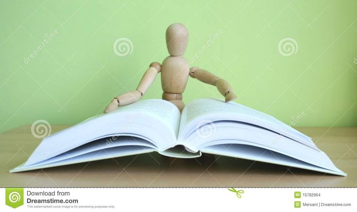 An open book and a reading puppet