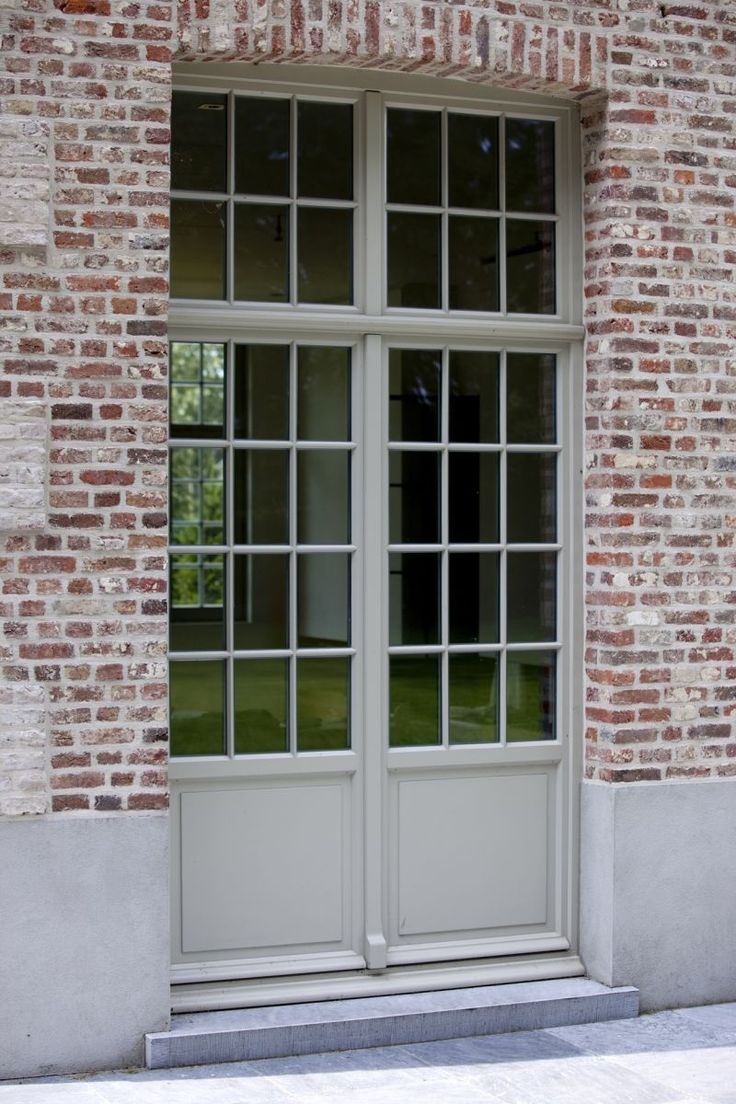 Belgian country living: blue stone, pale blue grey trimwork and brick