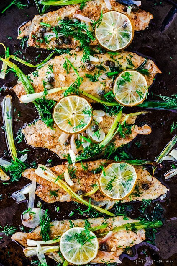 15-minute Baked Sole Fillet Recipe| The Mediterranean Dish. Fish fillets baked with green onions and capers, covered in a buttery lime sauce and garnished with fresh dill. Absolutely delicious! http://www.themediterraneandish.com/baked-sole-fillet-mediterranean-way/